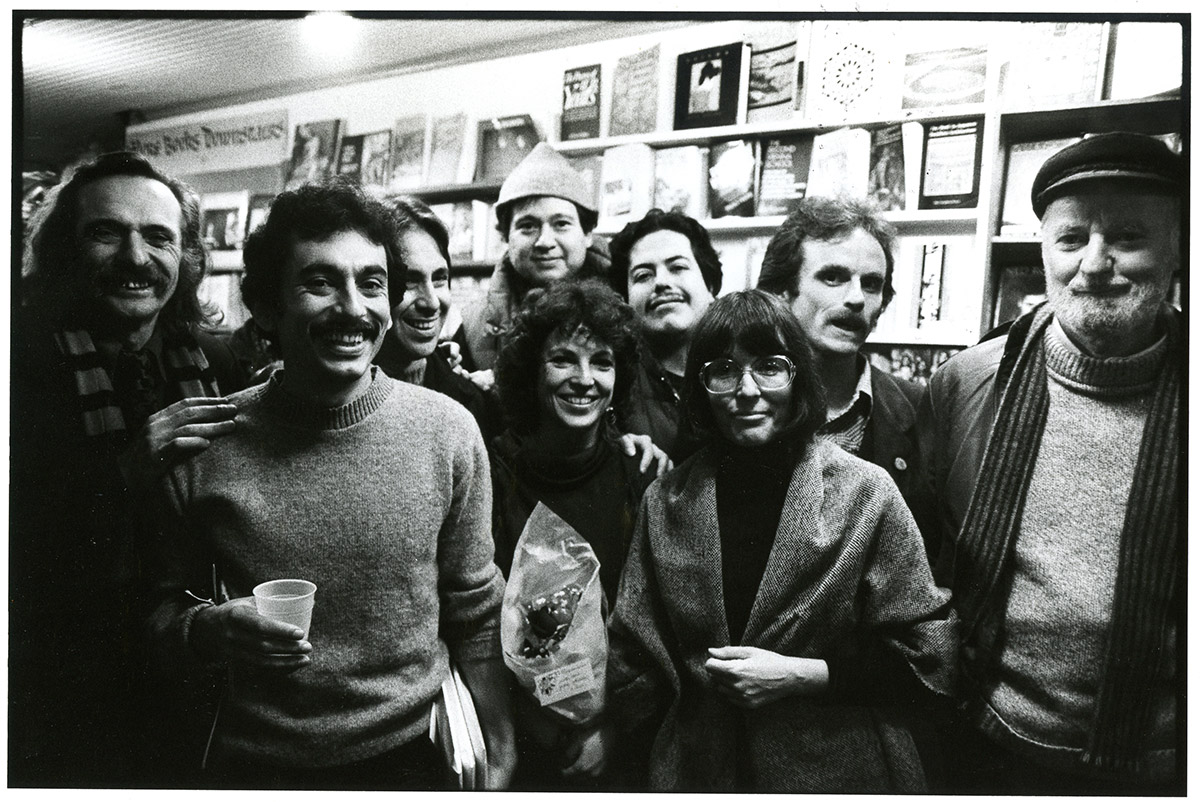 Group of authors, including Lawrence Ferlinghetti, smiling at the camera