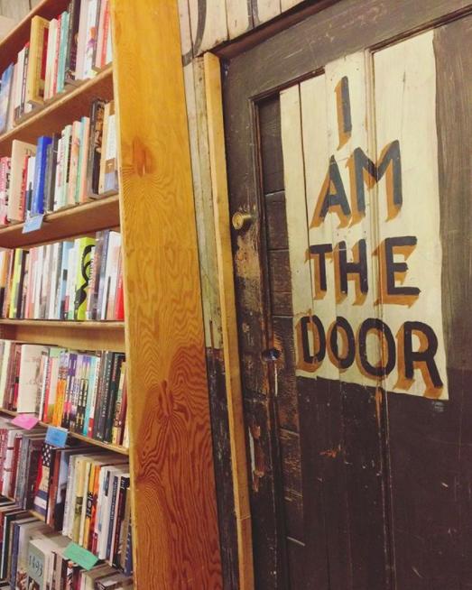 Old painted door that reads I AM THE DOOR