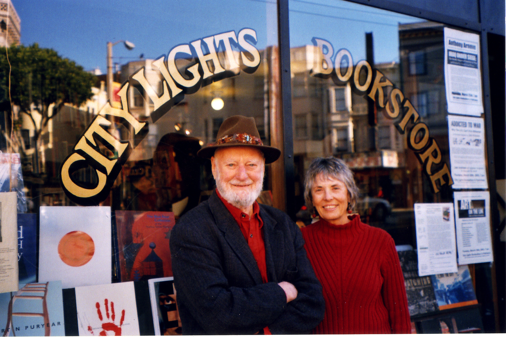 Lawrence Ferlinghetti and Nancy Peters posing together outside the store in 2001