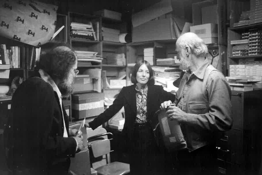 Allen Ginsberg, editor Nancy Peters and Lawrencer Ferlinghetti chat inside the publishing offices