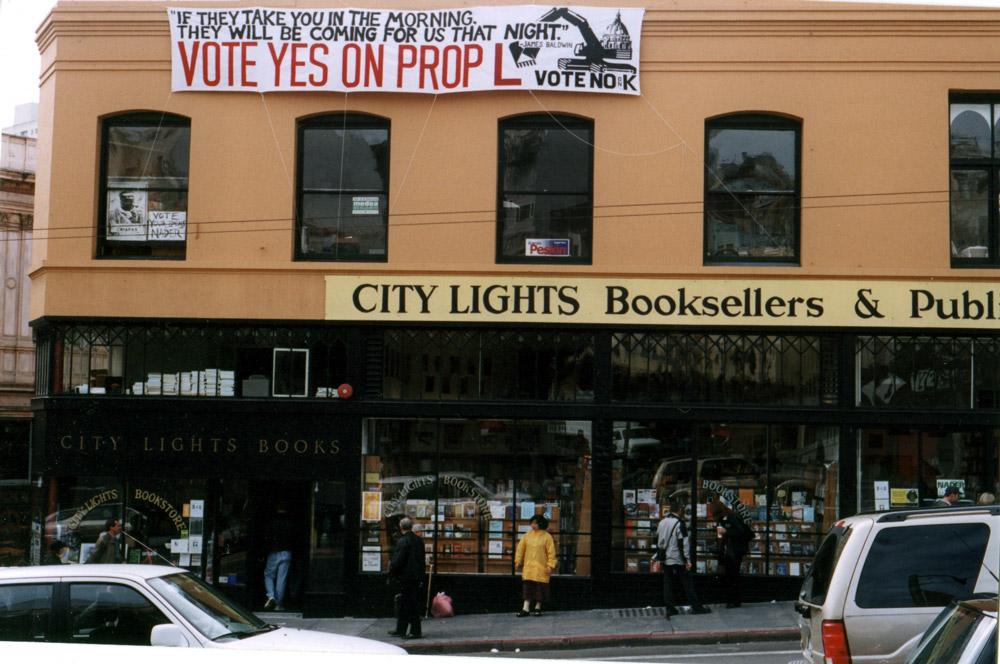 City Lights storefront with a large banner that reads VOTE YES ON PROP L