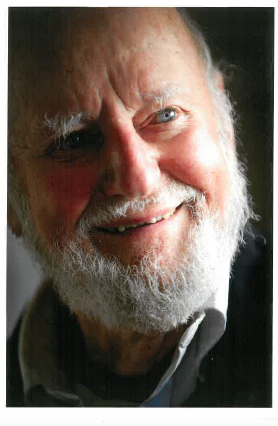 An old Ferlinghetti, smiling at the camera