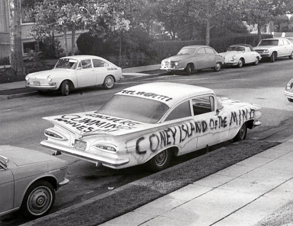 1950s car spray-painted with words CONEY ISLAND OF THE MIND on its side